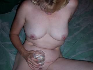 a little wine and someone to suck on her tits and she is ready to go
