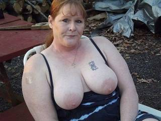 My wife letting her big tits hang out beside the campfire