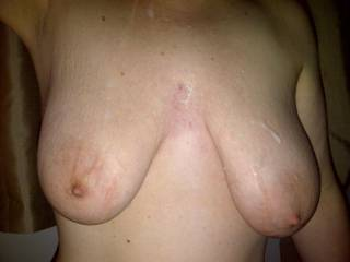 Sticky load running off her big soft tits