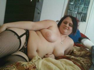 pretty slave laying in bed