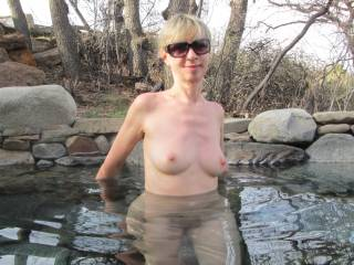 nude women shows body in water