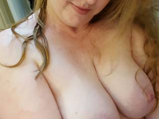 Hubby says I look smug in this picture, as I admire my own breasts... he says they are perfect... what do you think?