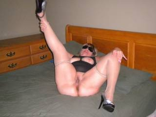 My hotwife's boyfriend ordered her to lay down on the bed and spread her legs while he snapped some photos. He fucked my wife while she was dressed in this outfit with her heels on!