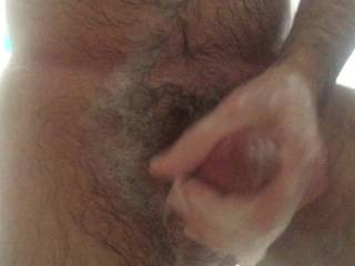 Shaving my balls.  Wish someone could shave them for me and stroke my cock and let me cum all over them