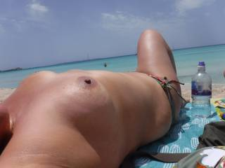 First time on a nudist beach....loved getting naked in front of people. Bikini bottoms on in this one, but they soon came off so everybody walking by could have a look at my pussy.