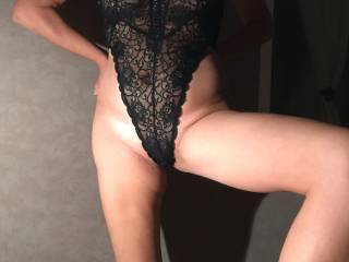 Is she sexy in this black body? I m horny and ready to fuck her