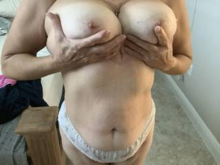 Wife holding her big boobs