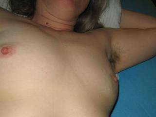 Sometimes, a picture is a bit unbalanced. In this case, two uncovered tits but only one exposed hairy pit.