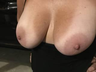 Flashing me her beautiful tits in the garage.