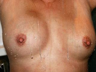 My coworker took a lot of photos of me in the shower.  Sharing one more with you.    Would you fondle my boobs, pinch my nipples, suck my nipples?  Are my nipples perky enough?