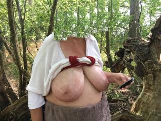 Rather casual - top up, tits out, tits oiled - then in the middle of woodland get phone out to see if any messages, without a care in the world. Lovely !