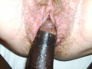 His big black cock and her wet hairy pussy