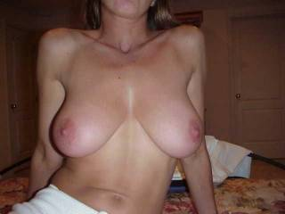 WOW!  Absolutely perfect natural tits from the size, shape and big aerola (my favorite!)...incredible body too!!