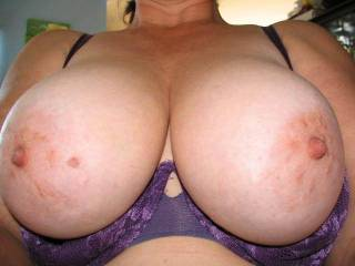 Mmmm, the more I watched you squeeze those big tits and suck and bite those hard nipples the harder I'd have to fuck you, and of course I wouldn't be able to resist unloading my throbbing cock on those beautiful tits!!