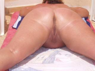 love the thought of rubbing suncream onto to you then lubing my cock and sliding it up your arse.....hubby takes photos while my missus sucks him off....happy days!