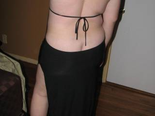 She is a great tease..would be nice to slip my hands down her back and help her out of that dress...mmm
