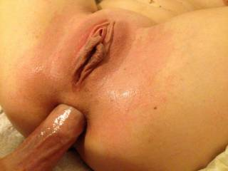 I would love to eat that pussy while you fuck her ass . . .  maybe pull out a time or two so I can taste her ass on your cock.