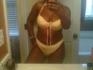 i do like that bathing suit too... but i'll suggest something much smaller... ummmh, may be a lace only... showing those tremendously sexy nd erect nips and under there just covering the hot as hell red opening and exposing those sweet awsome lips of that hottest wet pussy.... how does hat sound to you?....