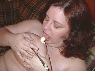 My wife licking icing off her nipple