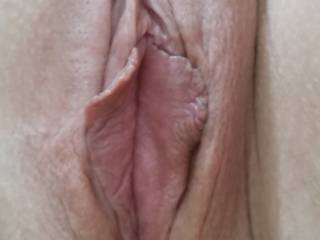 That pussy's slit is so inviting. Would love to pull the flaps wide open so I can watch my big cock head slip its way into your wet hole.