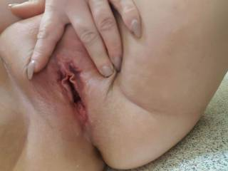 Opening my pussy lips. Would you like to slide your cock into my wet pussy