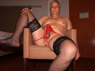 Posing with red panties and black stockings.