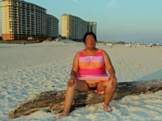 Upskirt pussy flash on a public beach!