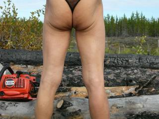 Me cutting firewood in my thong