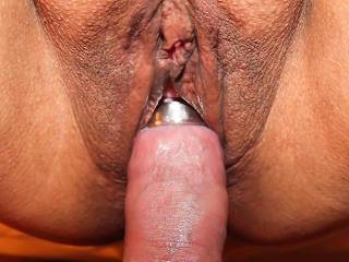 Hubby wearing a steel head ring on his cock...slipping it into my smooth, wet pussy!