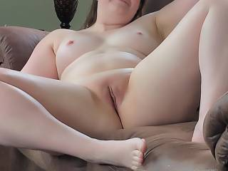 Wife spreading her legs while watching tv.