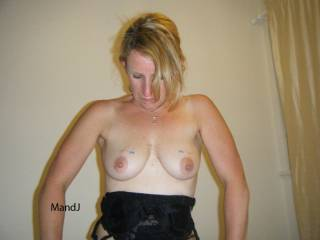 just admiring my pierced tits , hope you like them too :-)