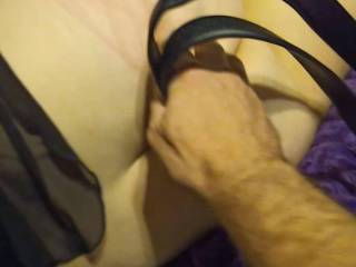 Using a belt to make some pretty lines on my girlfriend\'s ass.