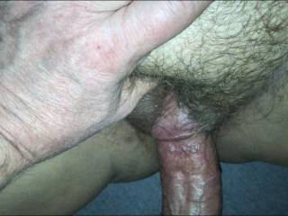 Rubbing my wife's clit as I fuck her.