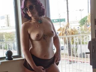 Hotwife teasing in hotel doorway