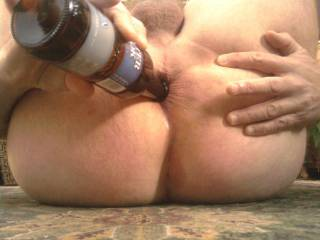 Fucking my own ass with a beer bottle - but I\'d rather be taking a strap-on inside me.