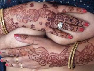 Indian wife's big tits covered by her beautiful, decorated hands.