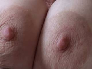 Girlfriend squeezing those big titties together so her nipples touch each other, and then I can suck on both nipples at the same time. Are her nipples looking good??