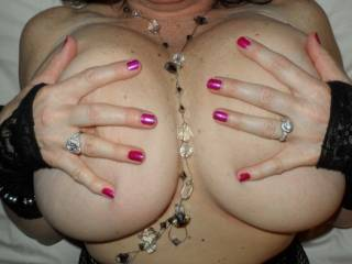 What is not to like big titties, sexy lips, and a wedding ring!!  These are a few of my favorite things!