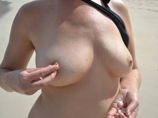My wife got a little horny on the beach and agreed to strip!  This is the first time she has ever done this, but she didn\'t think anyone else would want to see her tits!  Let us know what you think! If you have good comments, we have plenty more photos an