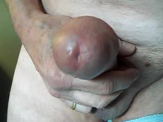 Slow stroke of fat cock with a creamy big ooze.