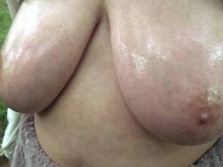 2 of 2 - jiggling. Made the same day as the previous four videos. Here she moves slightly, while her tits are out (and oiled), and they move around pleasingly