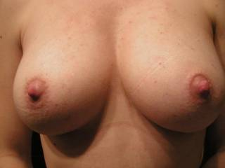 Great tits, Now we know why she has a load in her mouth. How could you not fuck those tits. Should cover them in cum and repost