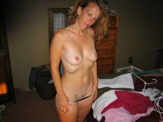 Mmmm, delicious.....strip hon.....and lets fuck.  Nice hot body and delicious breasts.  Mmmm, one sexy lady.  Hubby and I would love to help you strip and get ready for a good fucking.  K & G
