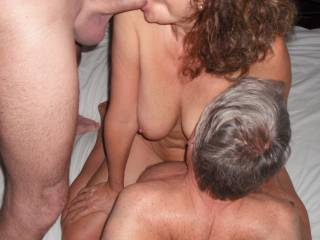 Threesome fun with our swinger friend. Riding his nice thick cock, whilst sucking my Hubby\'s lovely smooth thick cock.