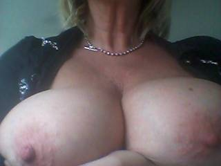 Absolutely magnificent tits...perfect size, big aerolas (my favorite!) and deliciously hard nipples just begging to be licked, sucked and nibbled on...I'm here to help!! :)