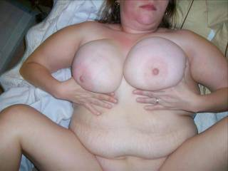 My fat wife playing with her big titties as I lay pipe in her hairy pussy.