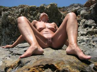 Nudist friend on the beach, she is something of an exhibitionist.