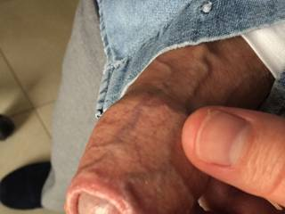 Holding the sheath as my cock slowly grows... Would you like to feel the still soft head with your lips?