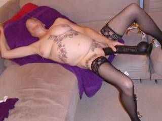 hi all I am at it again I do enjoy my big black dildo makes me come everytime. comments please mature couple