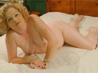 my mature wife posing naked on bed showing her pussy, tits, and ass